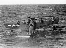 Warbird Picture - Downed American airmen near Truk await rescue on the wings of an OS2U Kingfisher