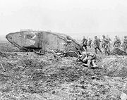 Canadian troops advancing behind a British Mark II tank at the Battle of Vimy Ridge