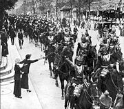 French heavy cavalry, wearing armoured breastplate and helmet, parade through Paris on the way to battle, August 1914