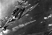 Airplane Pictures - American aircraft attacking a Japanese cruiser at the Battle of Midway.