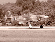Airplane Pictures - Modern built Yak-9 on takeoff at World War II Air Show, Reading, PA, 2002